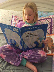 Ella, age 5, is reading Polar Bear, Polar Bear, What do you see? Another Eric Carle favorite