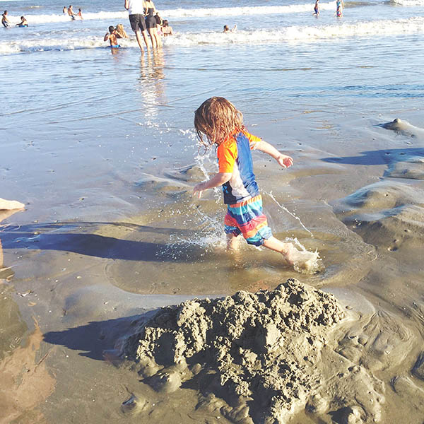 little boy running at the beach