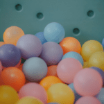Close up image of plastic pastel balls in ball pit